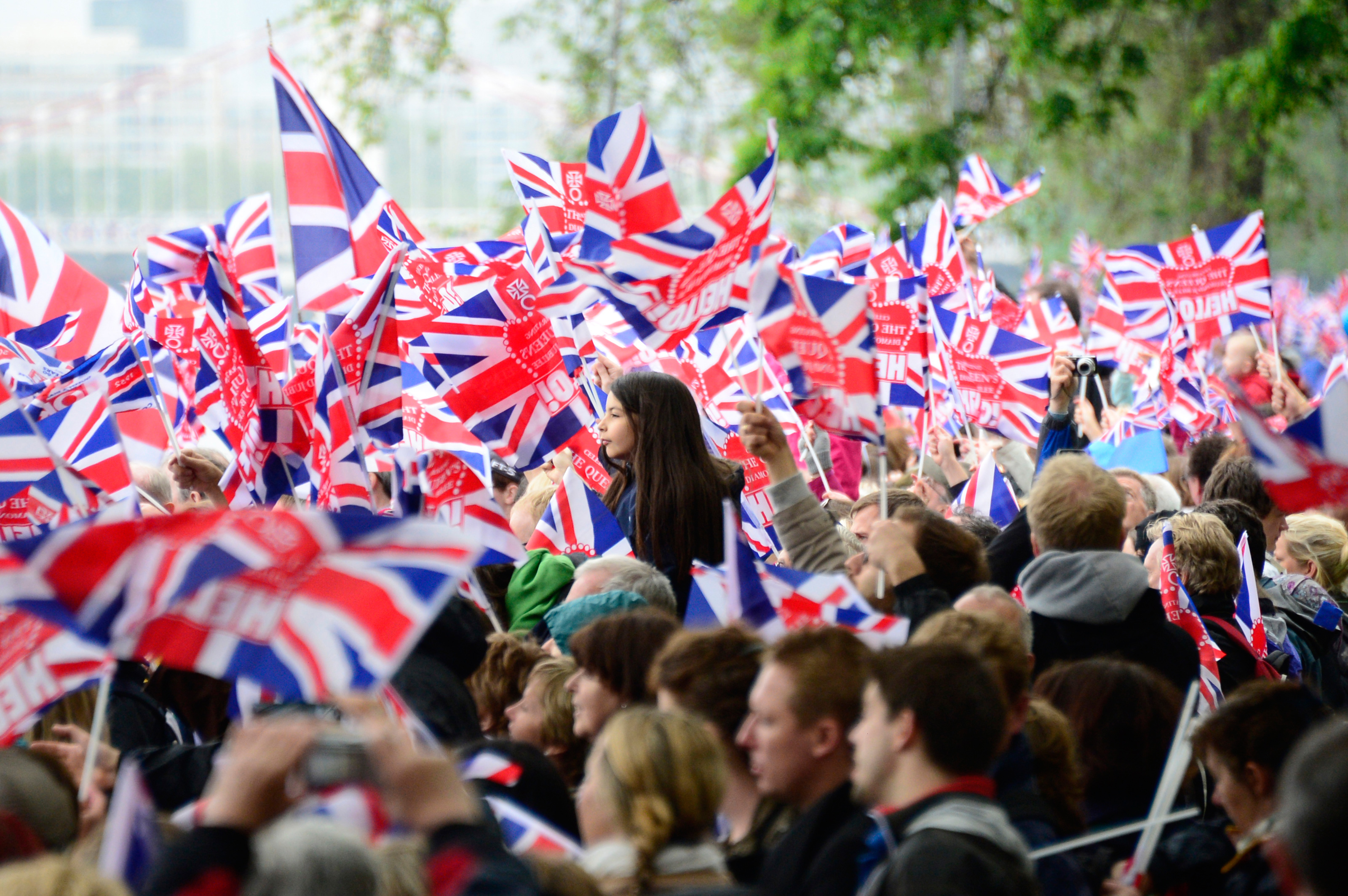 people-line-the-banks-waving-britains-union-flags-data